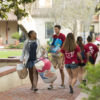 Parents and volunteers help students move into the dorms at Lagunita.