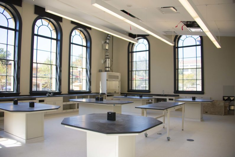 Lab classroom in large, open room with large windows offering view over campus