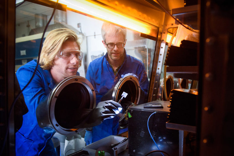Stanford post-doctoral scholar Tomas Leijtens and Professor Mike McGehee examine perovskite tandem solar cells.