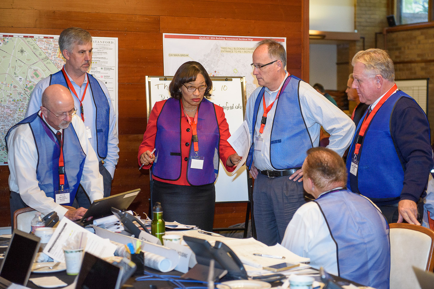Senior associate vice provost Shirley Everett, center, speaks with other administrators at the QuakeSU 2016 exercise in the Emergency Operations Center.