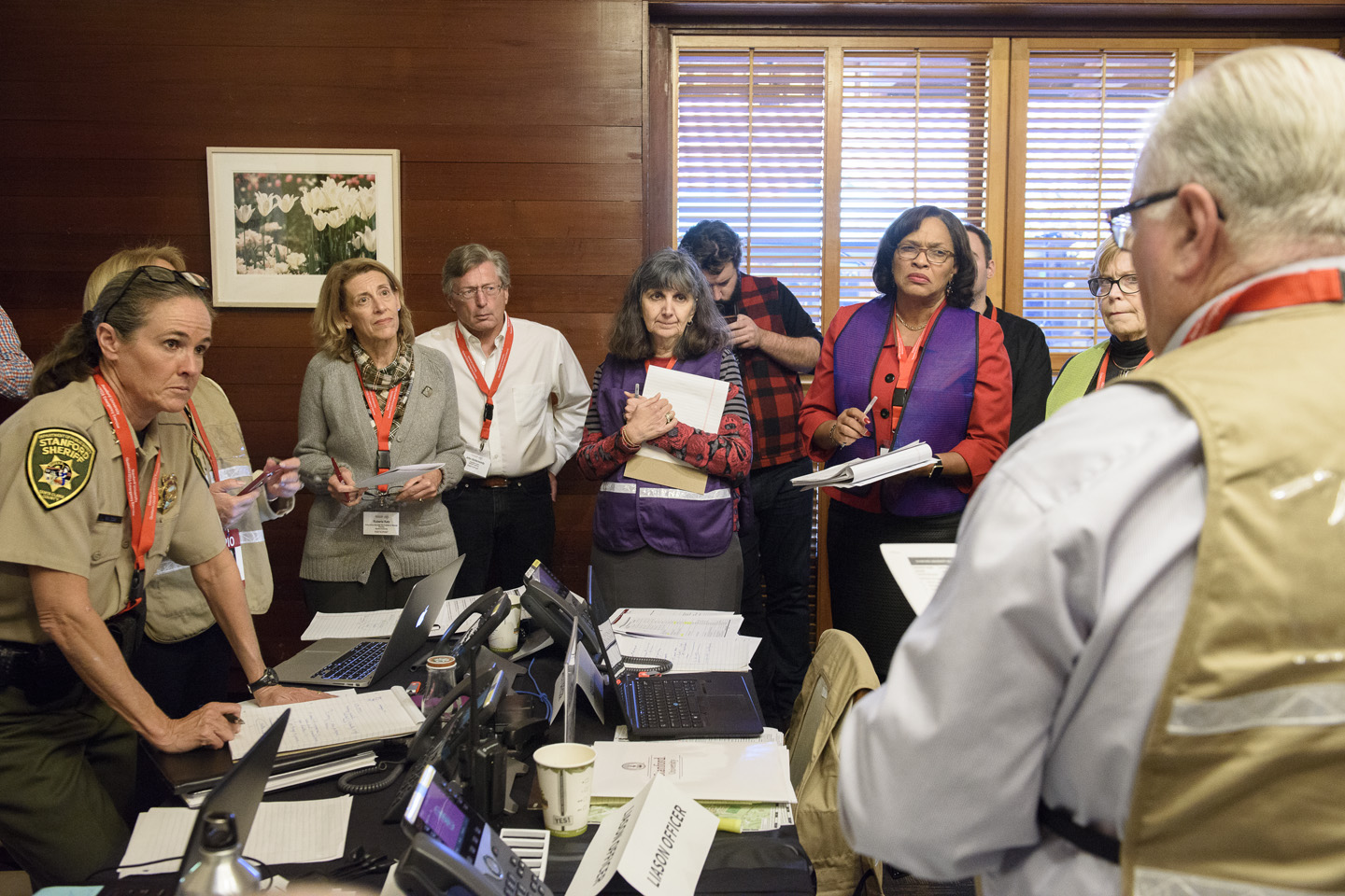 Participants in the Emergency Operations Center listen to Associate Vice Provost for Environmental Health and Safety Larry Gibbs, right, as the exercise moves to a close.