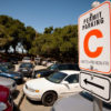 "08/10/2010 Parking lot near Lake Lagunita, with ""C"" permit sign. Credit: Linda A. Cicero / Stanford News Service"