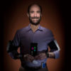 geneticist Michael Snyder wearing seven biosensors that collect data about his health