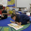 elementary students reading in a classroom