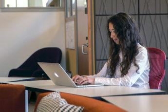 Young woman at computer.