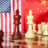 Chess pieces with American and Chinese flags