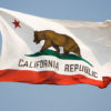 California flag flying with blue sky in background