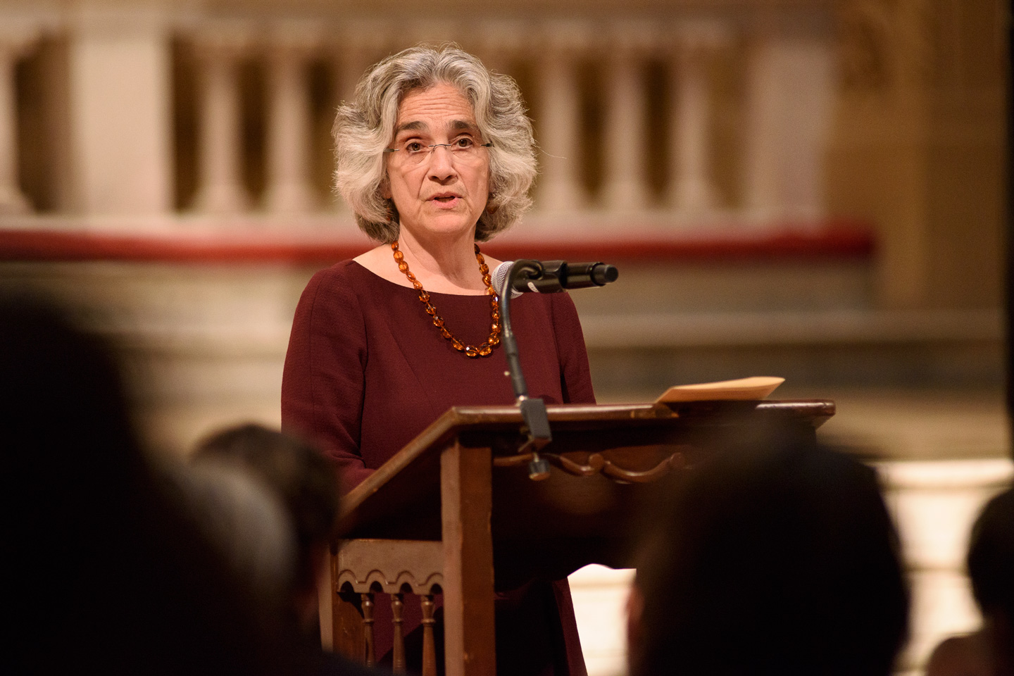 Persis Drell at lectern in Memorial Church during Inauguration Day community gathering