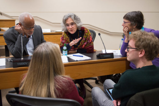 Members of the Faculty Senate in discussion.
