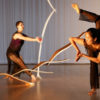"Dancers Sarah Ribeiro-Broomhead and Cora Cliburn perform ""In a Winter Garden"" with a sculpture by Will Clift."