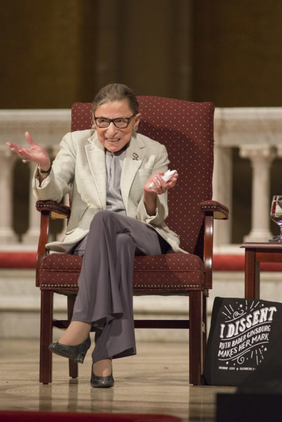 Ruth Bader Ginsburg in a chair