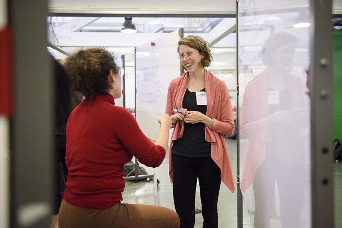 Research engineer Jennifer Hicks (facing) in discussion with Ilenia Battiato, assistant professor of energy resources engineering