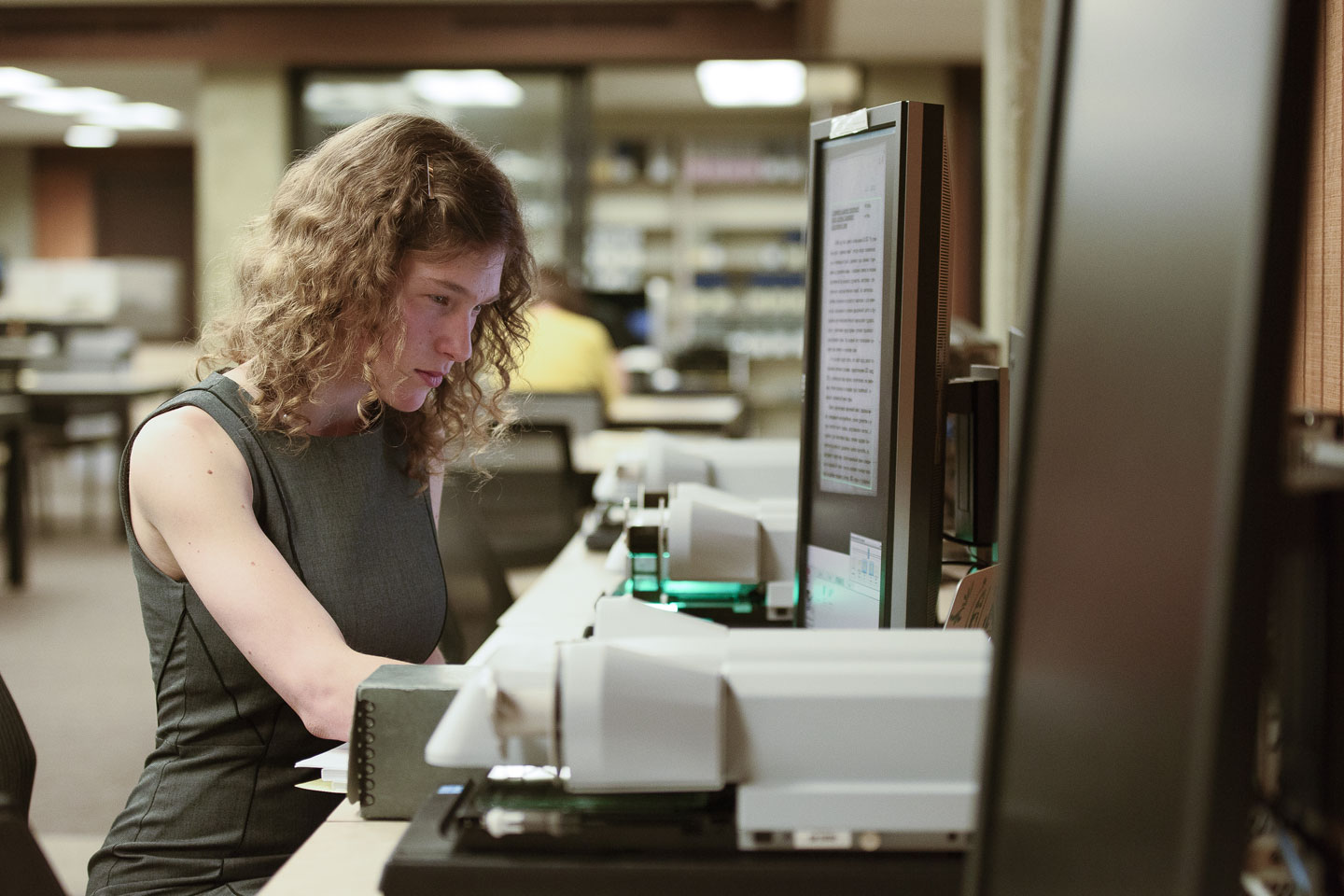 Anna Polishchuk translates documents from the original Russian at the Hoover Archives.