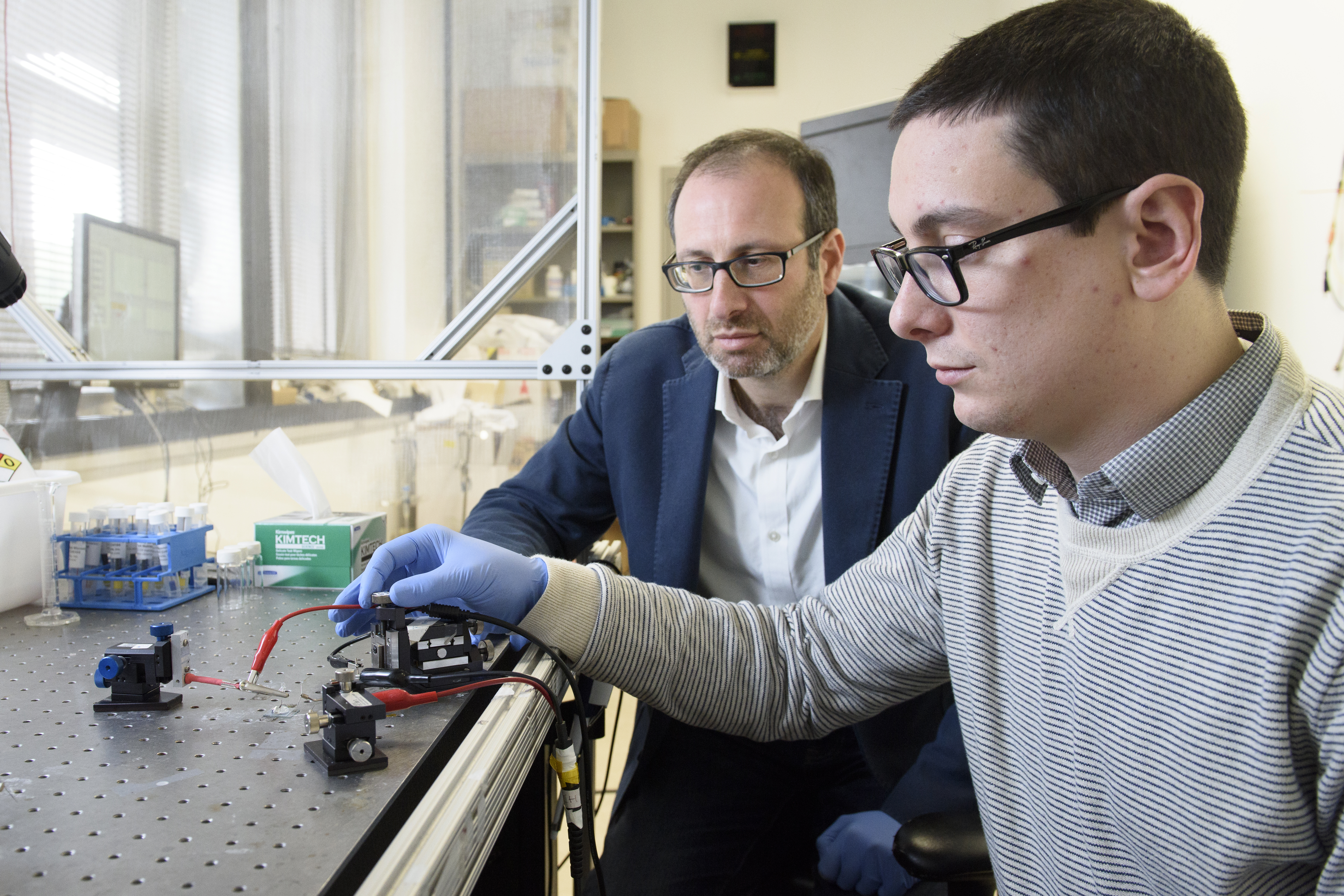Prof. Alberto Salleo and graduate student Scott Keene in the lab