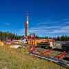 fracking rig near forested area
