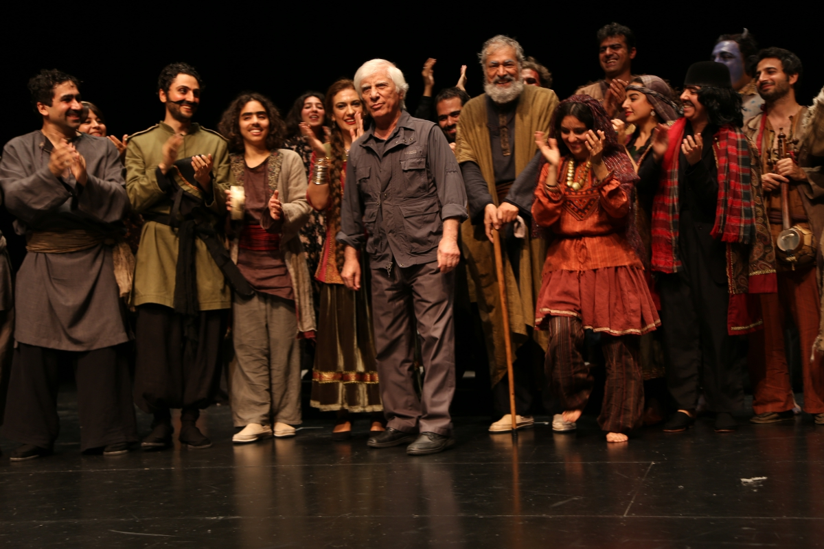 Director Bahram Beyzaie shares the stage with his actors after a Stanford performance of the Iranian play Tarabnameh.