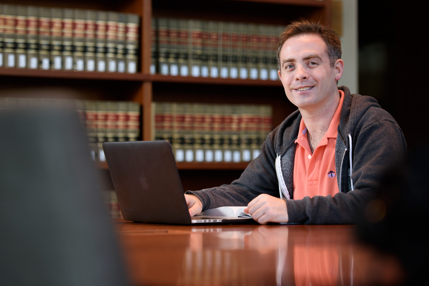 Veteran and law student Benjamin E. Haas, studying at the Law School.