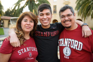 Freshman Javier Covarrubias with his parents Maria and Javier Covarrubias.
