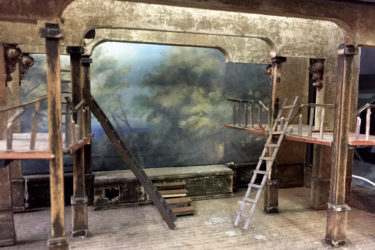 Set of production of Shakespeare's The Tempest: abandoned Jacobean theater updated with a stage-within-a-stage.