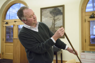 Senior librarian and curator of the sequoia collection Benjamin Stone with a souvenir cane made from a sequoia tree.