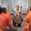 Stanford Artist-In-Residence, cellist Christopher Costanza, of the St. Lawrence String Quartet, speaks to a group of inmates at the San Francisco county jail during an appearance at the jail where they performed and answered questions about the music and their instruments.