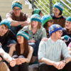 Heidi Arjes, a postdoctoral scholar in bioengineering, center, has created knit hat designs for the April 22 March for Science. Designs feature a DNA double helix, lab glassware, a circuit with a battery and three resistors, a space shuttle, wind turbines and others.
