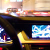 car dashboard and navigation system illuminated at night