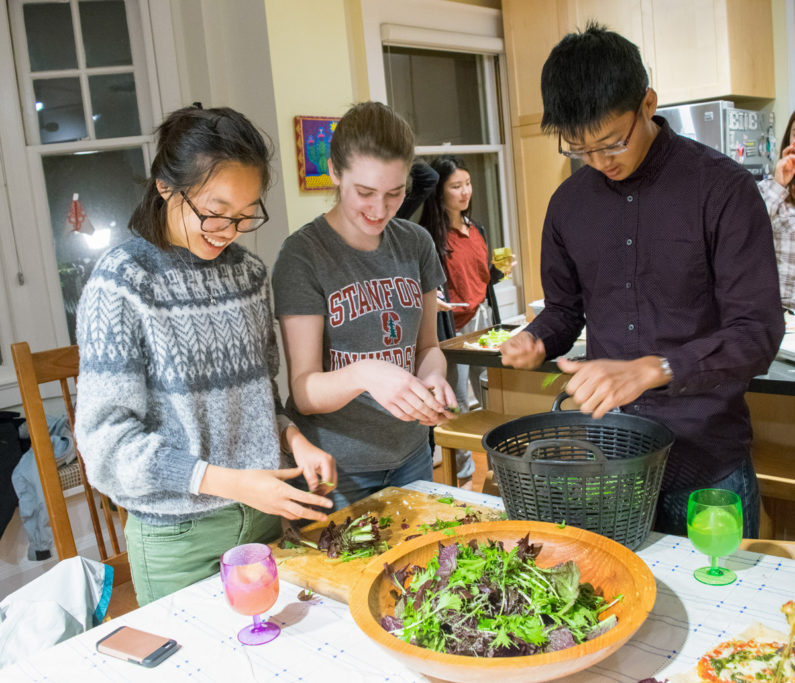 3 students make salad