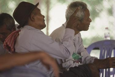 three Cambodian men, seated