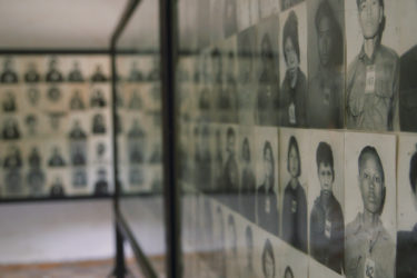 walls of photos of genocide victims