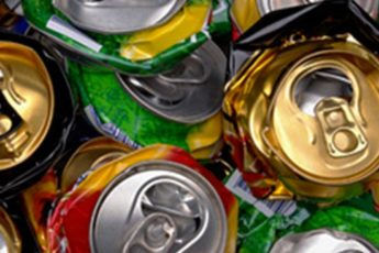 Close up photo of many crushed soda cans