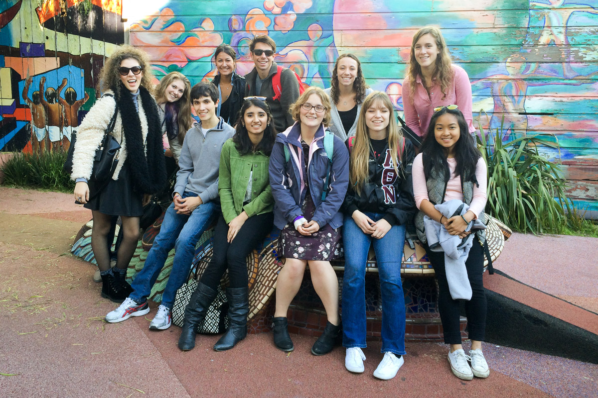 students in front of a mural in San Francisco's Mission District