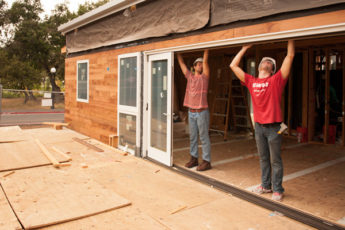 Students install the sliding doors on the start.home