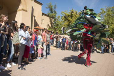 The Tree, mascot of the Stanford Band, dances and spins for the crowd outside Memorial Auditorium.