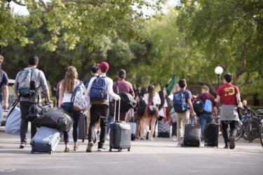 ProFros make their way across White Plaza to their dorm