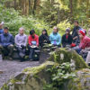 class meeting in Alaskan forest