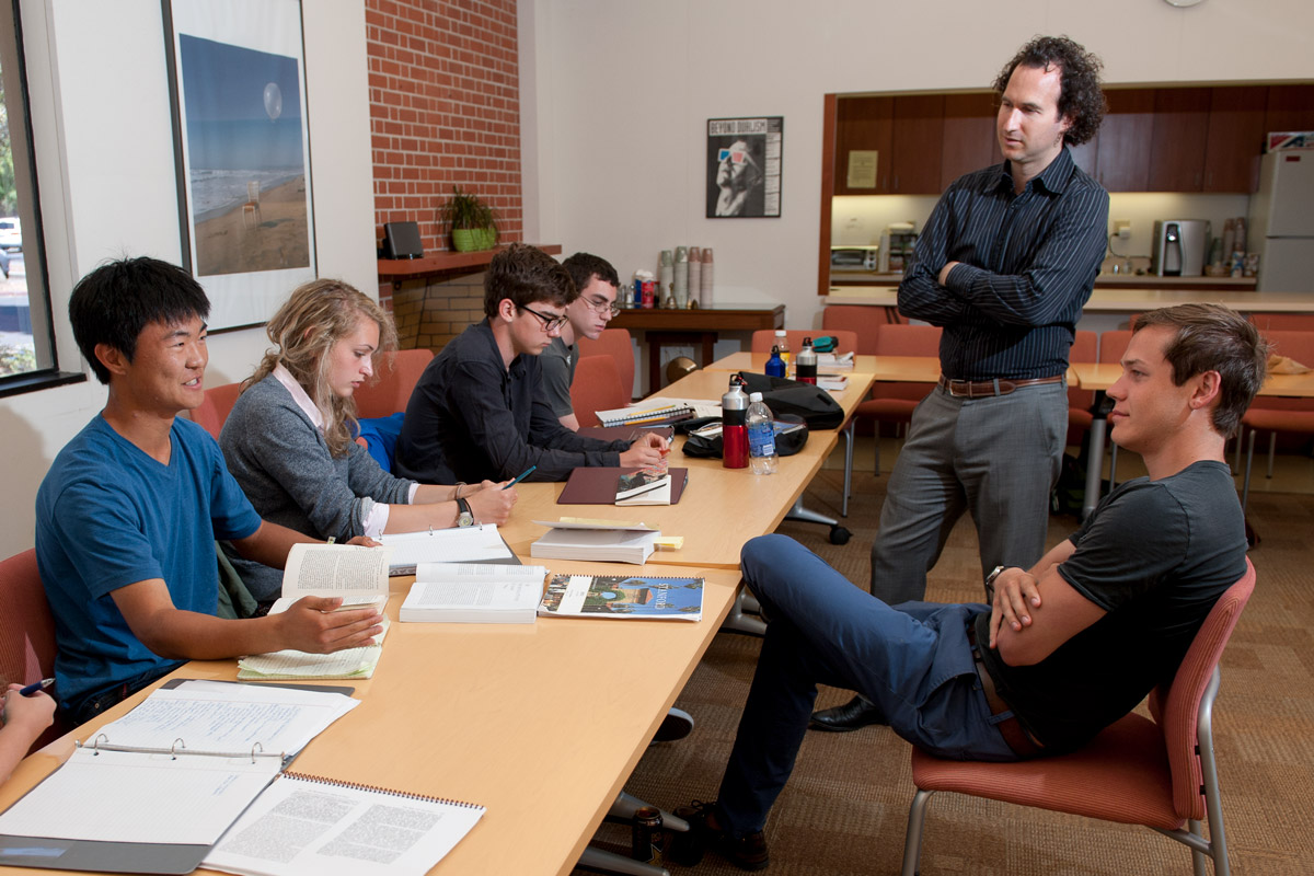 7/2/2012 Stanford Summer Humanities Institute (SSHI). Ryan Lee, Abby Coleman, Sean Watson, and John Pitre participate in a small group discussion with associate professor of French and Italian Dan Edelstein (standing) and resident counselor Nathan Lindborg.