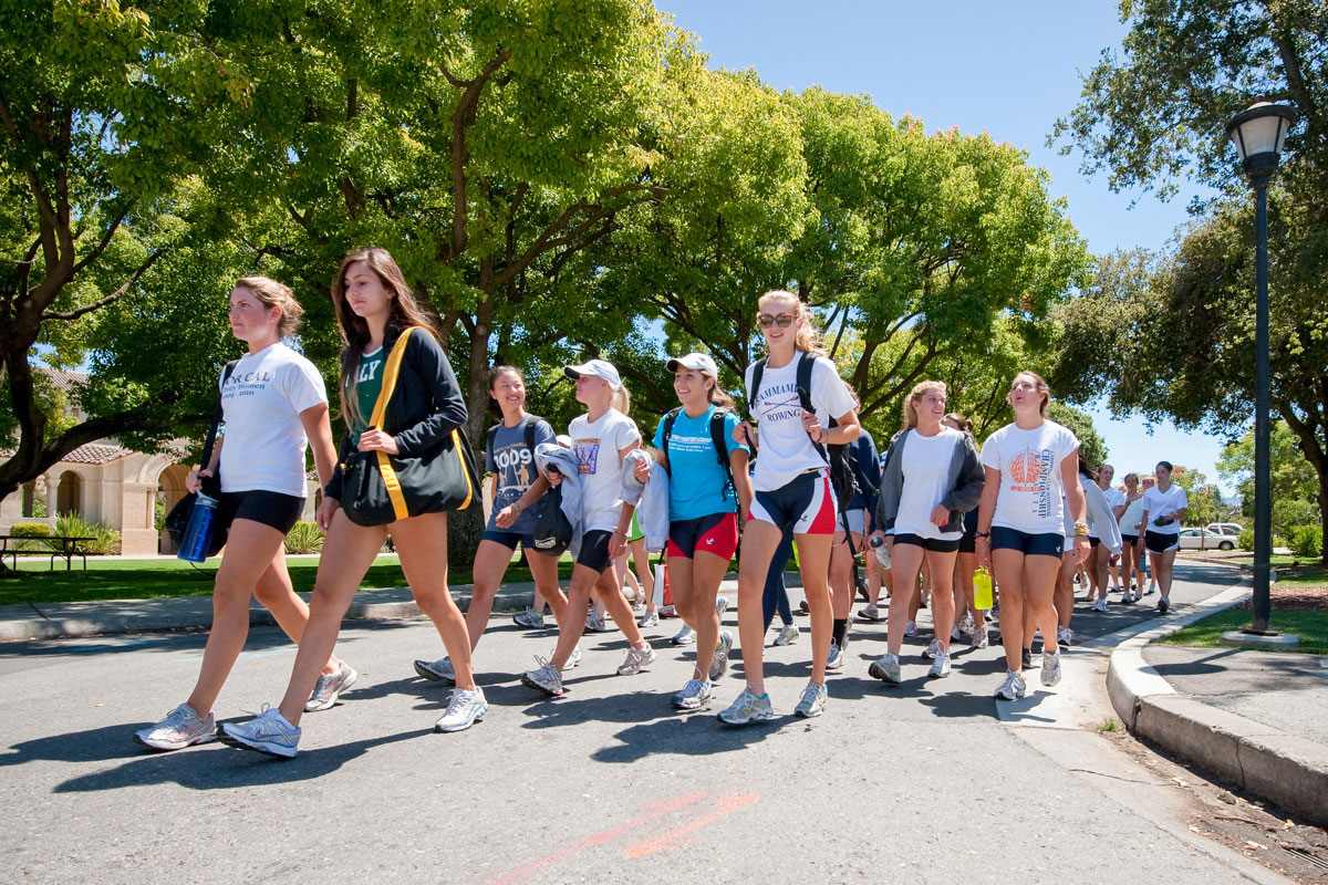 Summer visitors participating in a rowing camp make their way from dorm to gym.