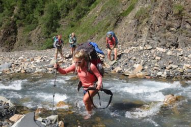 The researchers and their siblings crossing Rex Creek.