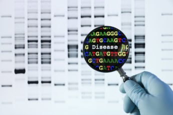 gloved hand holding a magnifying glass to view a DNA sequence that reveals a disease