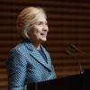 Hillary Clinton speaking at podium