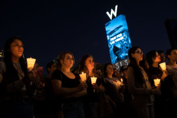 LAS VEGAS, NV - OCTOBER 2: Mourners attend a candlelight vigil at the corner of Sahara Avenue and Las Vegas Boulevard for the victims of Sunday night's mass shooting, October 2, 2017 in Las Vegas, Nevada. Late Sunday night, a lone gunman killed more than 50 people and injured more than 500 people after he opened fire on a large crowd at the Route 91 Harvest Festival, a three-day country music festival. The massacre is one of the deadliest mass shooting events in U.S. history.