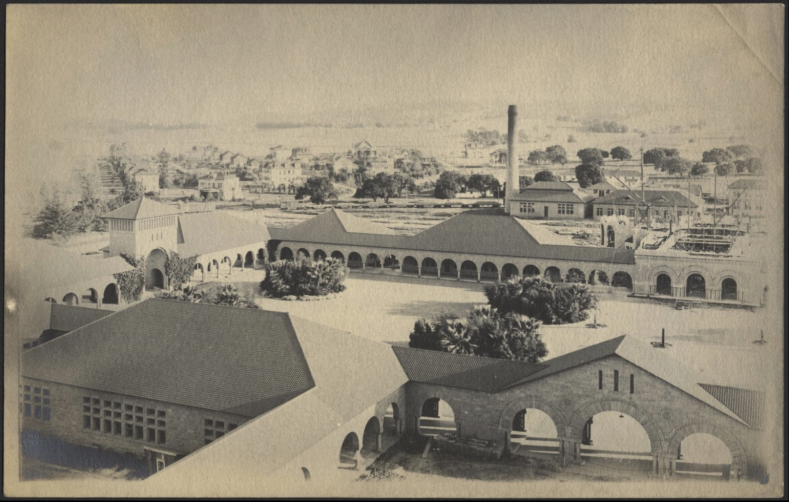 A photo from the 1890s shows the power house, which is the building with the chimney, where Julius Andrew Quelle, then Stanford student, set up his printing shop initially.