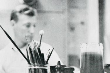 A Stanford University Press designer works at his desk in 1959.