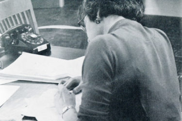 A 1959 photo shows an editor working at the press.