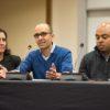 Stacey Bent, Ramesh Johari and Bryan Brown seated at a table. Johari speaking
