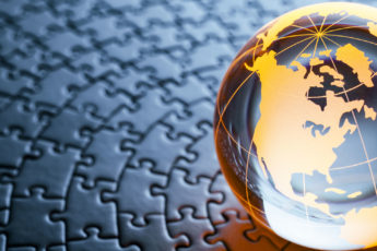 crystal globe featuring North America on a jigsaw puzzle background