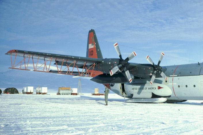 An American military C-130 cargo plane converted for Antarctic radar surveys at Williams Field in Antarctica's McMurdo Sound.