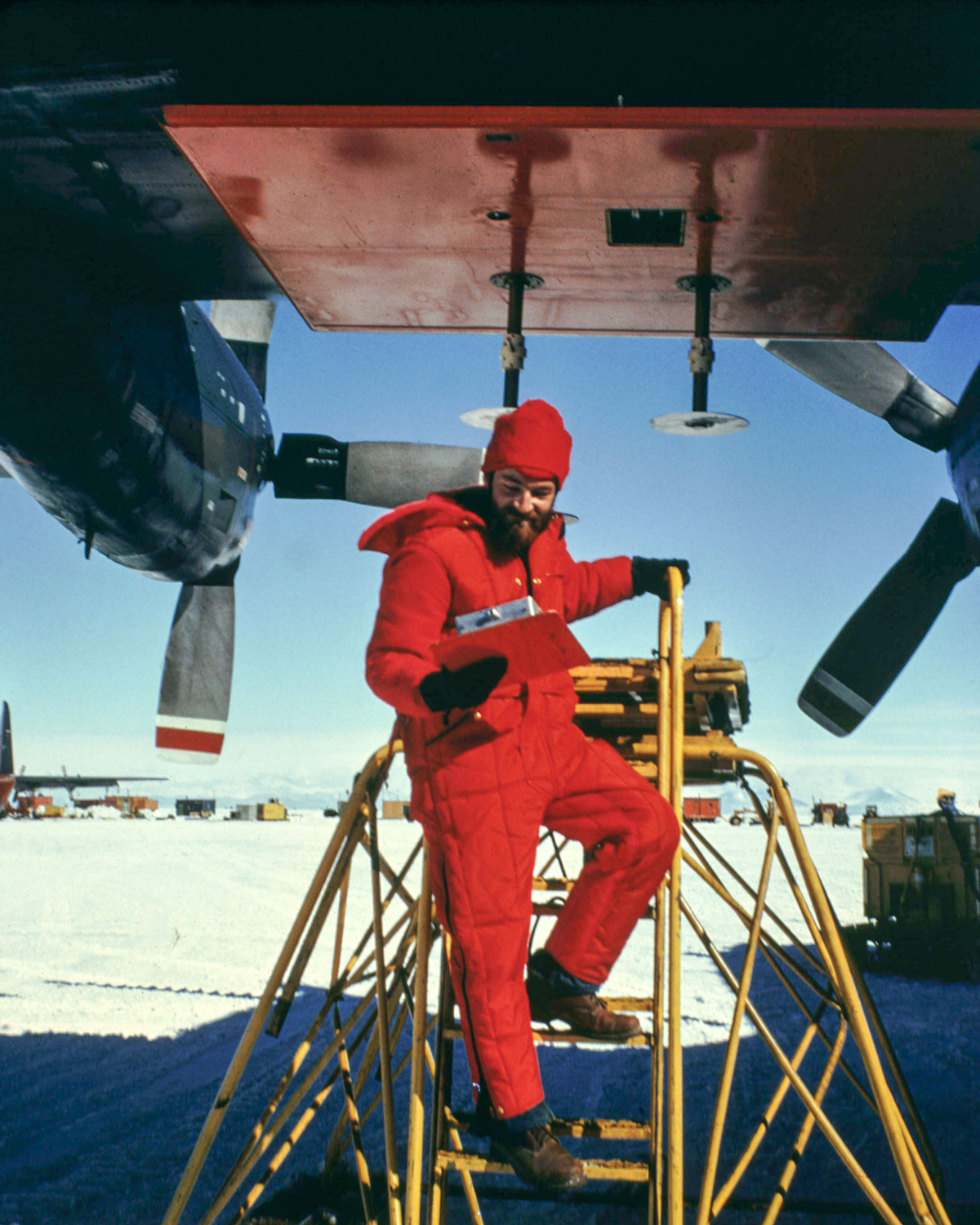 Nils Sko undertaking maintenance on a 300MHz radar antenna on a C-130 plane at McMurdo Sound in Antarctica.