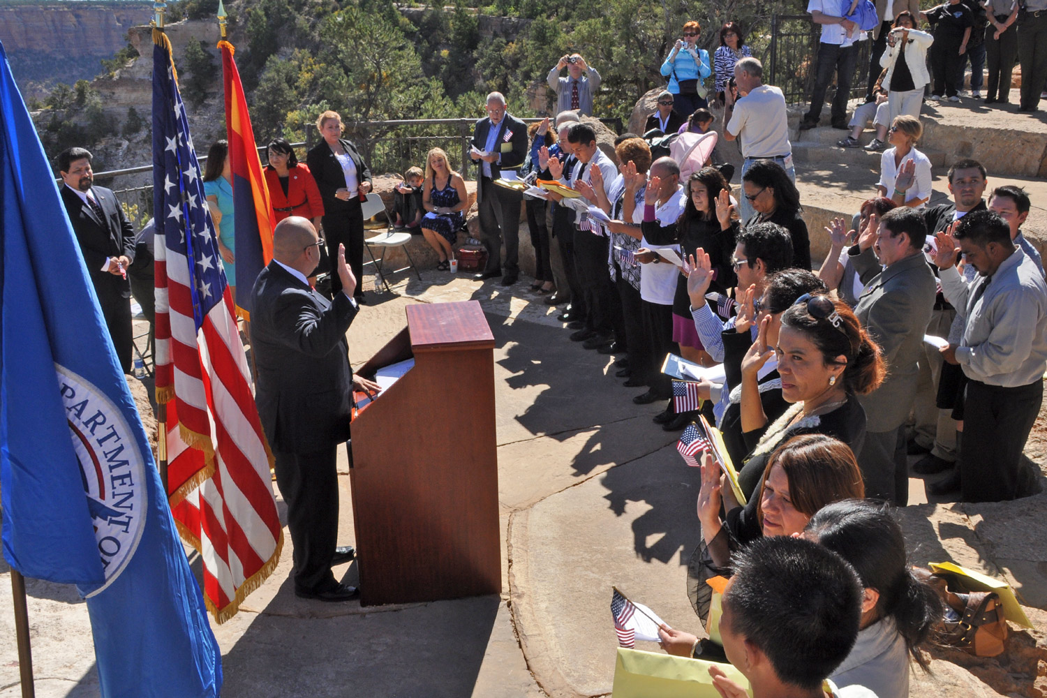 Immigrants take the oath of citizenship during a ceremony on the South Rim of the Grand Canyon. (Image credit: Michael Quinn/National Park Service)